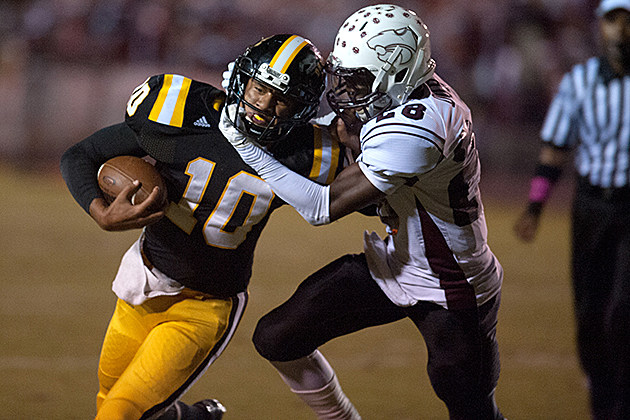 Nacogdoches quarterback Bryce Matthews is brought down by Whitehouse's Chris Reese during the Dragons' 43-21 loss Oct. 25 in Nacogdoches. (Christopher Vinn, ETSN.fm)