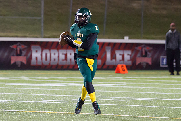 Longview quarterback Dezmond Chumley looks for an open receiver during