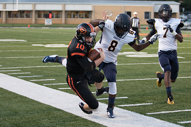 Pine Tree cornerback Kenny Jackson (8) puts a hit on Gilmer quarterback Zac Spears (10) in the two team's Sep. 4 game. Gilmer, the defending Class 4A Division II state champion, won 35-19.  (Ruel Felipe, ETSN.fm)
