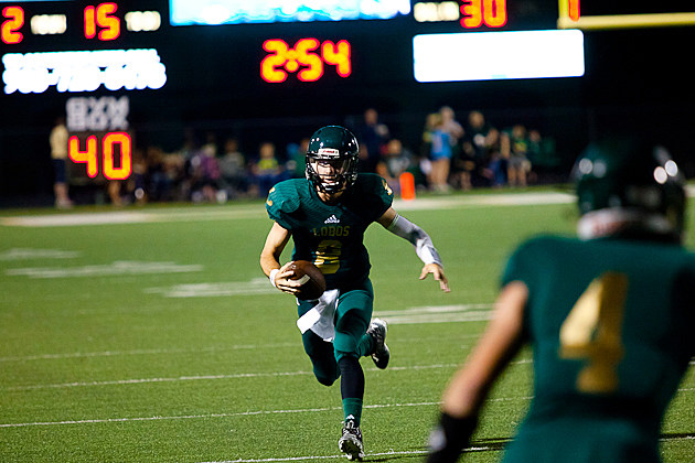 Longview quarterback Michael Ross looks for room to run during the Lobos' 61-6 home rout of Pine Tree on Sept. 25. (Trey Bell, ETSN.fm)