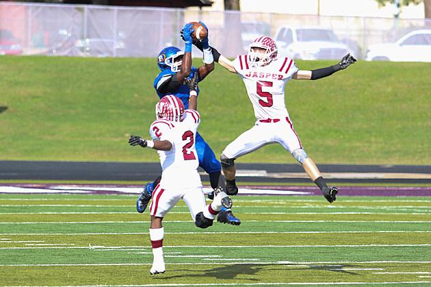 Brownsboro Xavier Richardson pulls down a catch, between two Jasper defenders.