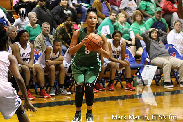 Tatum's S. Gipson attemps a three pointer.