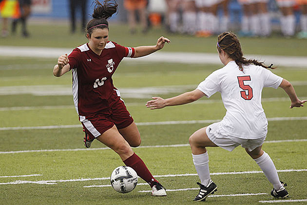 Lady Dawgs defender Caitlyn Warren tries to find open field against Salado's Morgan Bird during their Class 4A state semifinal on April 13, 2016, in Georgetown. (Stephen Spillman, ETSN.fm)