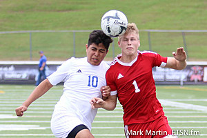 Kilgore's Spencer Stegall and Henderson's Hector Salazer battle for possession as a 1-1 late in regulation continues.
