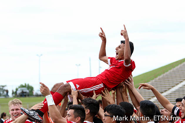 The Kilgore soccer team hoists Yonatan Contreras in the air shortly after the junior midfielder scored in overtime to guide the Bulldogs into the UIL Soccer State Tournament field.