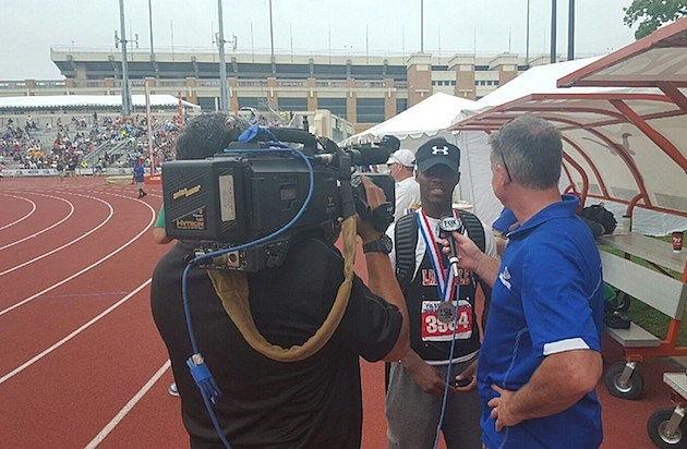 Laneville's Ladarius Arnett is interviewed after setting the Class A boys state record in the long jump on May 14,2016, in Austin. (Courtesy, Laneville ISD)