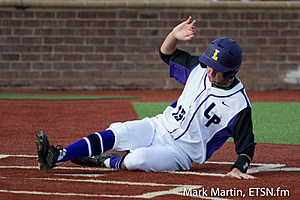 Lufkin Dylan Murphy slides into home for a score.