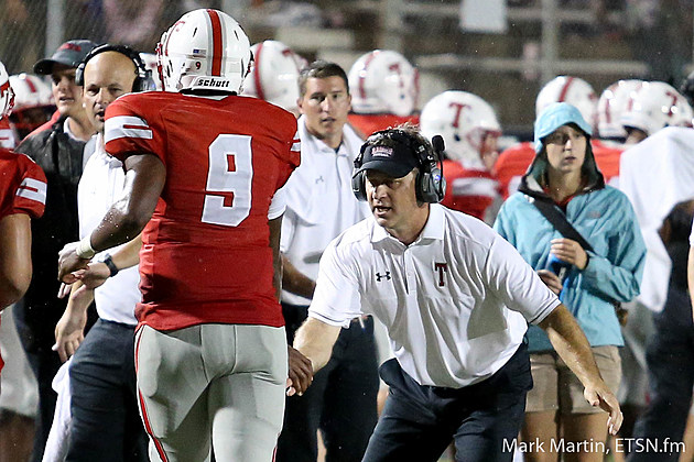 Tyler Lee coach Clayton George celebrates with quarterback Chance Amie during the Red Raiders' 34-7 season-opening win against Marshall.