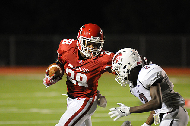 Carthage running back Keaontay Ingram (28) tries to run past Whitehouse's Javier Neal (2) during their game Sept. 9 in Carthage. (Bud Worley, ETSN.fm)