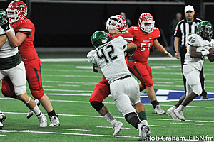 Kennedale linebacker Michael Landers catches Van quarterback Garrett Moseley for a 1-yard gain. Moseley, the Vandals' leading rusher, got held for a net of 15 yards on the ground.