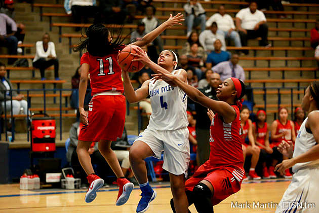 John Tyler Alyssa Mayfield goes between two defender, for a layup.