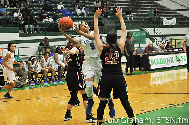 Lady Lions guard Destini Whitehead (5), pictured in Friday's district playoff game against Rockwall-Heath, scored a game-best 14 points Monday against Lufkin in the bi-district round of the 6A playoffs.