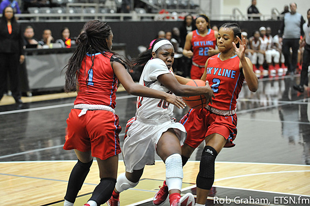 Lee guard Tyreesha Blaylock drives the lane against a Skyline double team by leading scorer Jaylan Gulley and Jade Bradley in Thursday's 52-26 area round loss in Kaufman.
